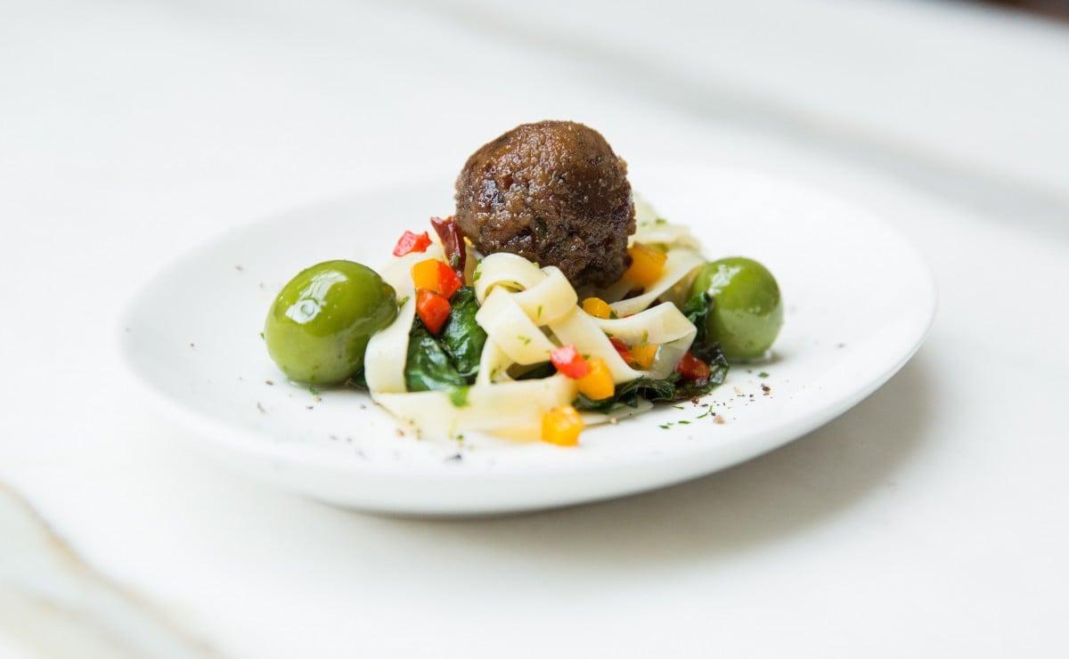 Plant-based meatball on pasta