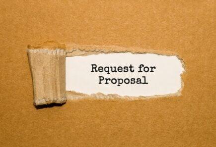 Request for Proposal written under torn cardboard