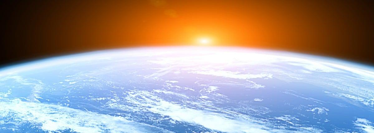 Sun rising over earth
