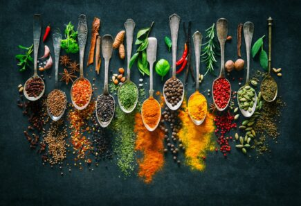 Spoons of spices and legumes