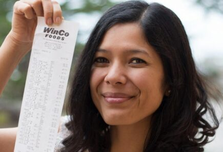 Person holding up WinCo receipt