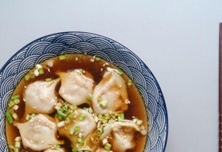 Plant-based dumplings in broth