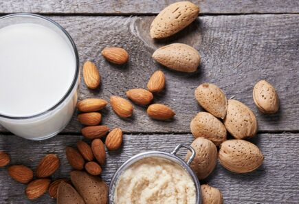 Nuts next to glass of milk