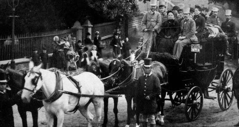 Black and white carriage and horses