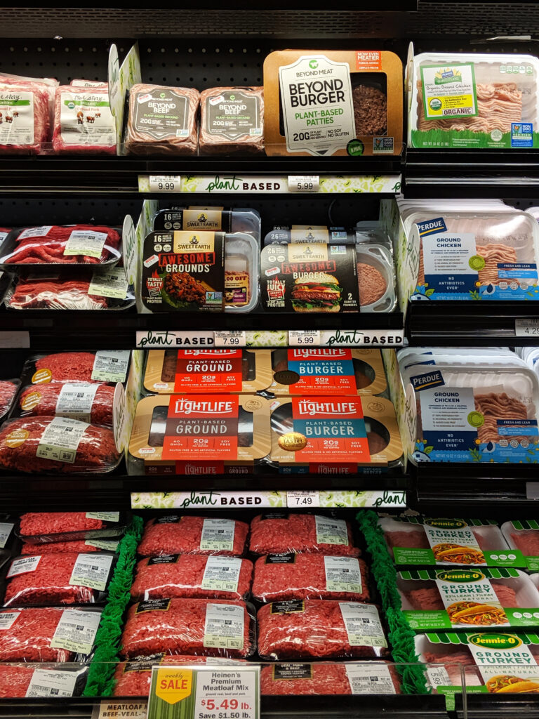 Plant-based meat shelved with conventional meat at heinen's.