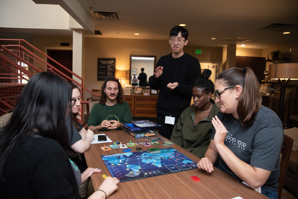 A group of GFI Staff gathered around a board game