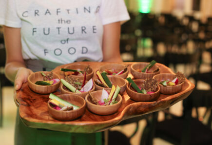 Server holding a tray of appetizers from a gfi brazil investment event