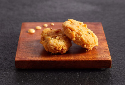 Two chicken bites on wood slate