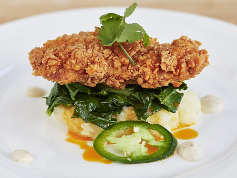 A battered and fried cultured meat, a cultured chicken cutlet, plated with sauteed greens and mashed root vegetables | Image courtesy of Memphis Meats