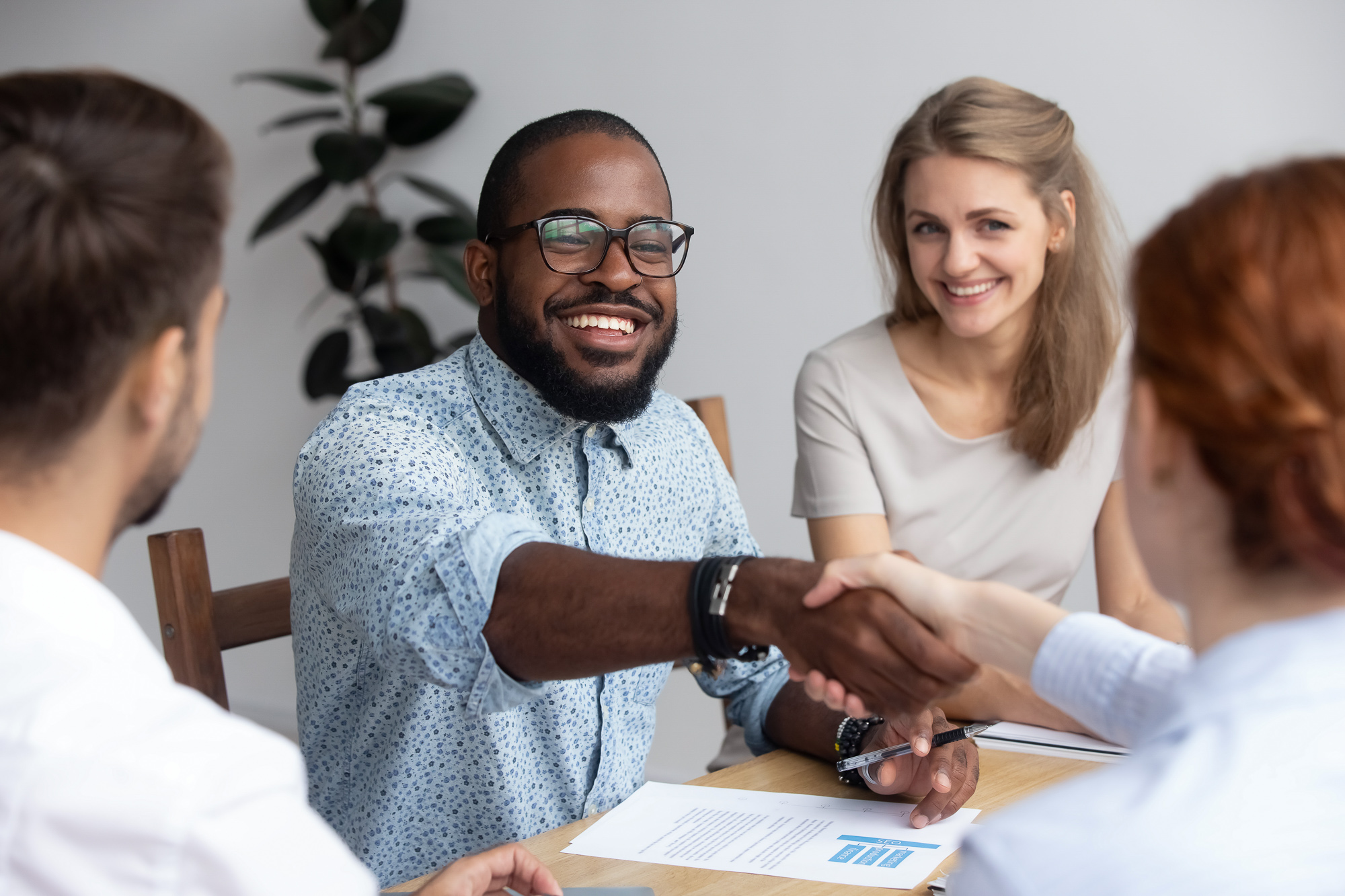 People shaking hands during a business meeting