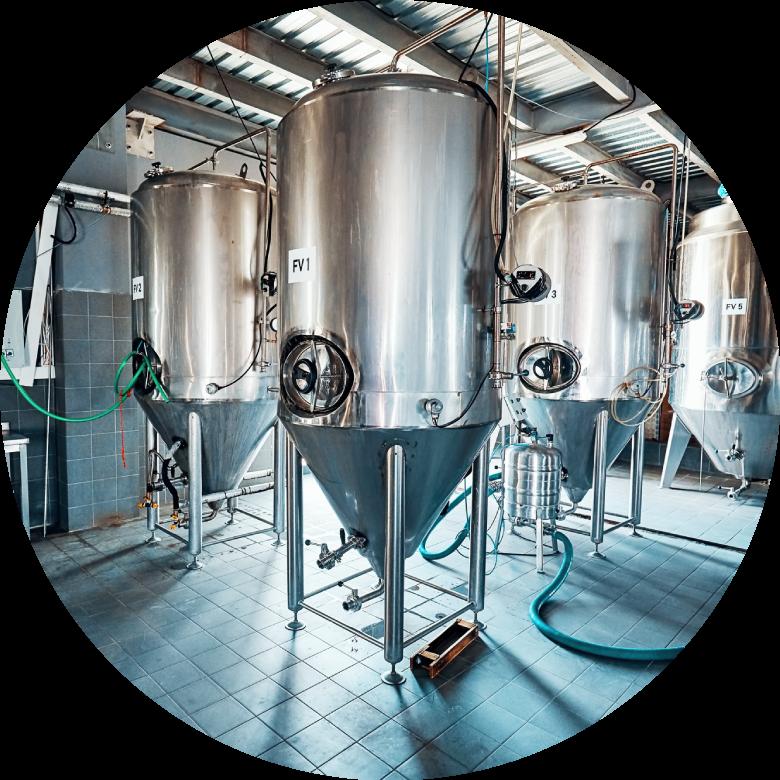 Fermentation tanks in an industrial room