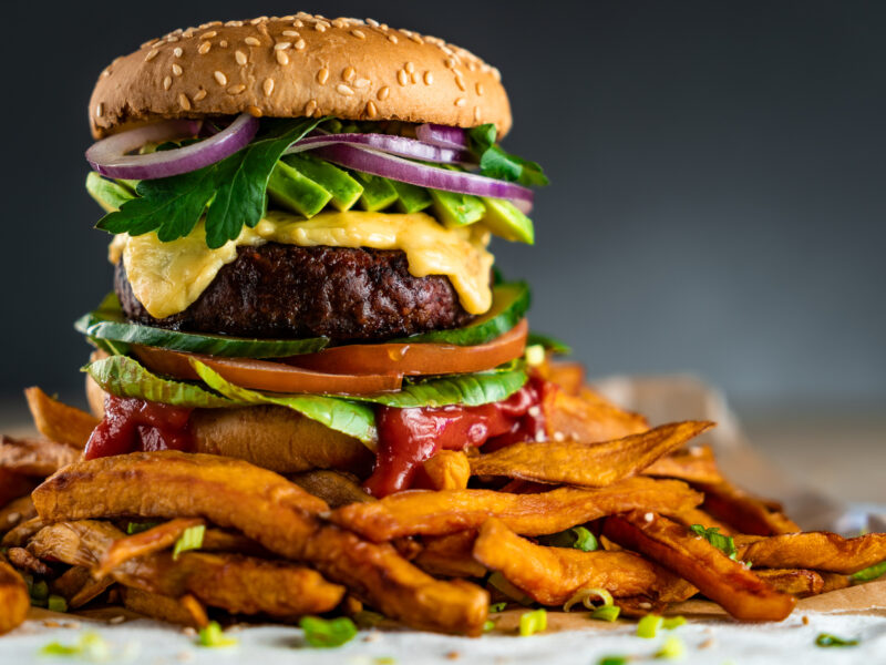 Homemade plant-based burger with sweet potato fries