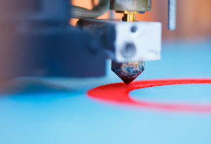 3d printer in action, representing bioprinting concept
