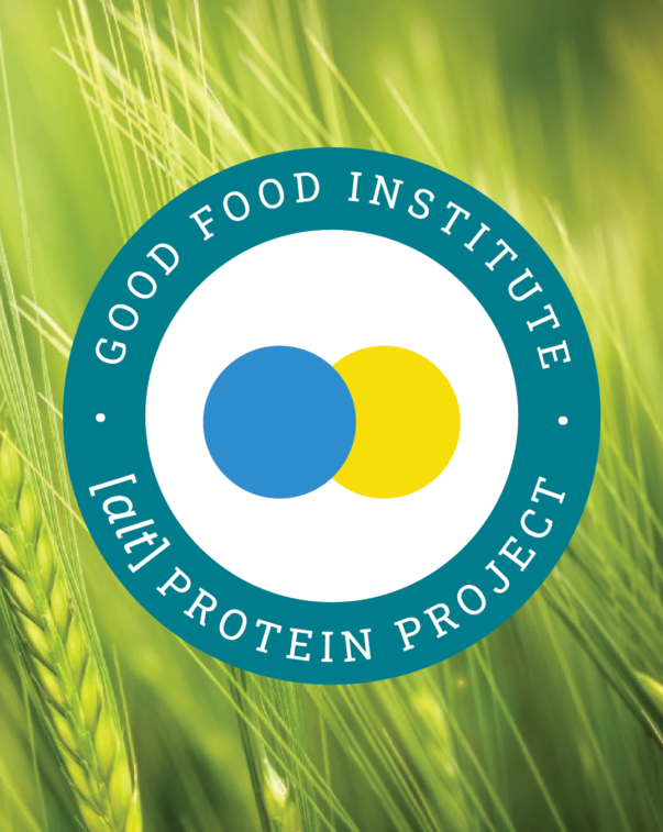 Alt protein project badge on a in front of a field of green wheat
