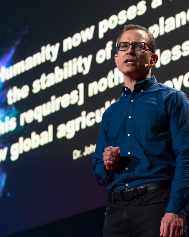 Bruce friedrich on stage during a ted talk presentation
