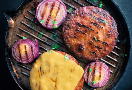 Plant-based burgers in a pan