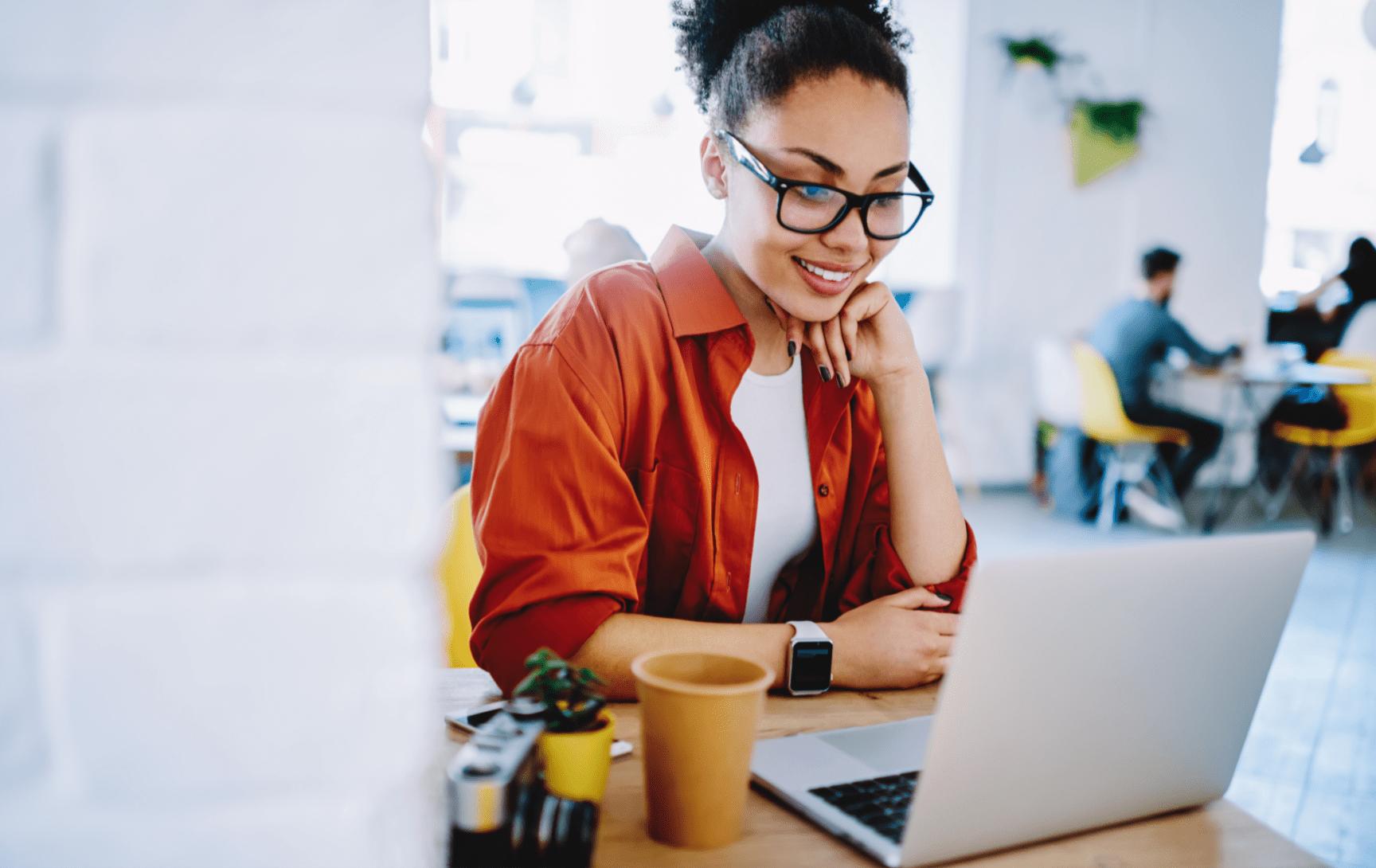 Woman at laptop smiling
